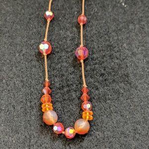 Orange bead and cord necklace